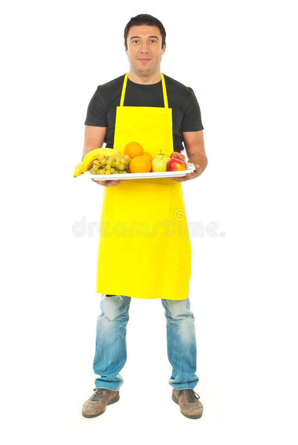 Full length of greengrocer with fruits royalty free stock photo