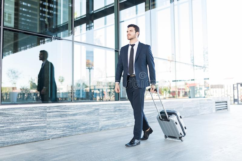 Formally Dressed Businessman With Suitcase stock photo