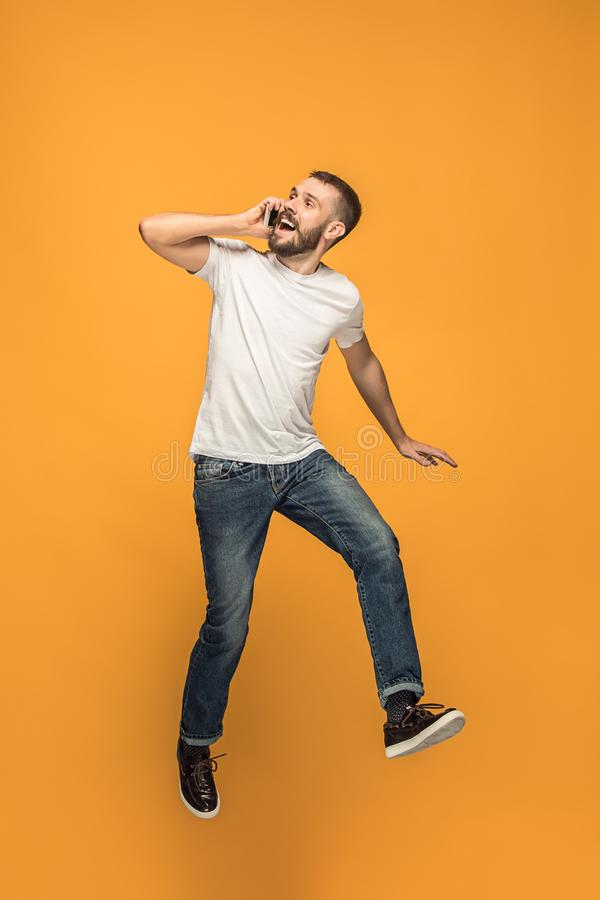 Full length of handsome young man taking selfie while jumping stock photo