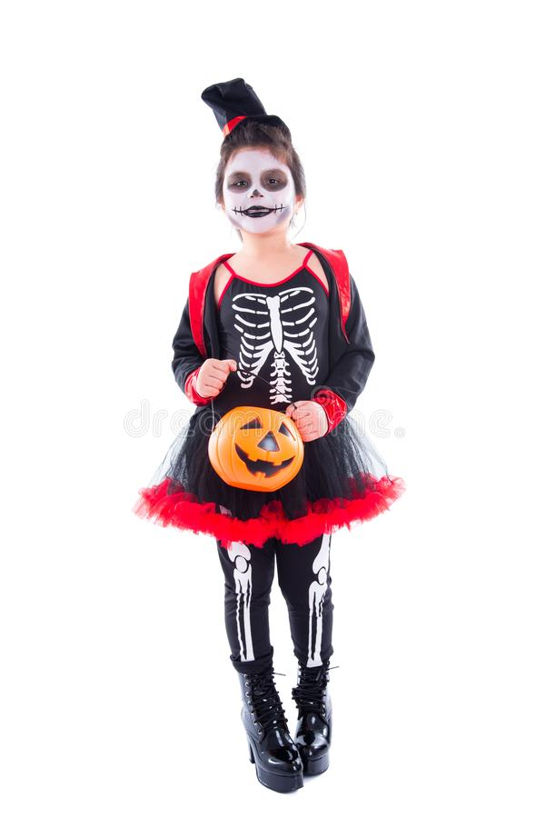 Full length of happy girl in halloween skeleton costume. Full length of happy asian girl in halloween skeleton costume isolated over white background stock photography