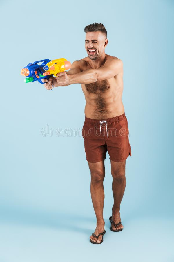 Full length of a happy handsome young shirtless man stock image