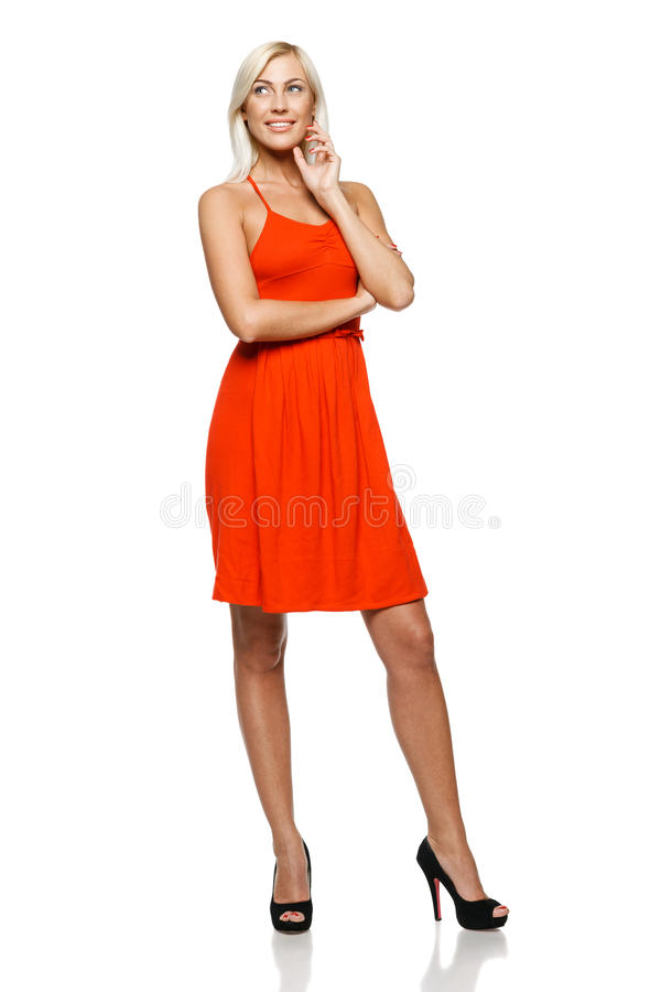 Full length of happy woman looking to side royalty free stock photography