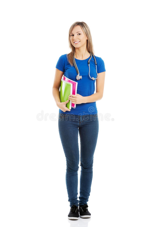 Full length happy woman with stethoscope royalty free stock images