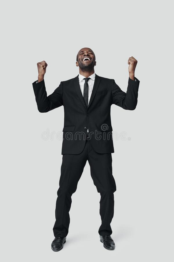 Full length of happy young African man in formalwear royalty free stock photos