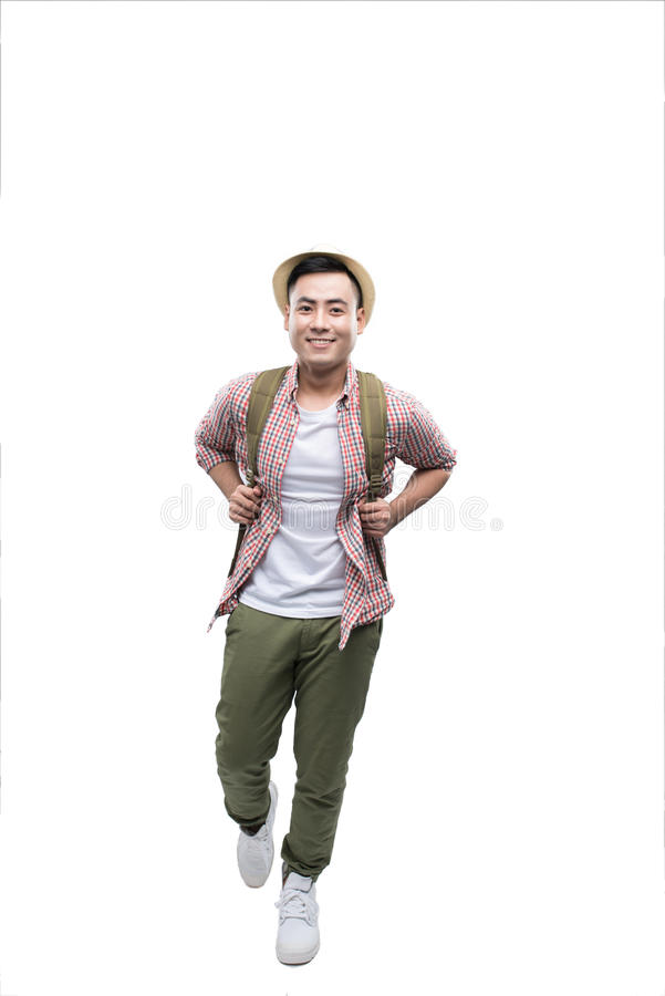 Full-length image of a going asian man ready to travel royalty free stock photography