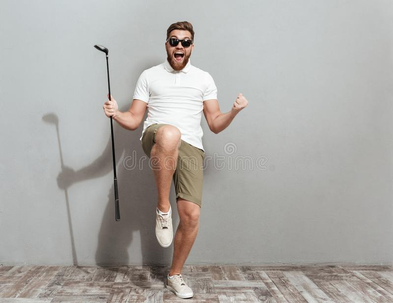 Full length image of a Happy Screaming golfer in sunglasses stock photo