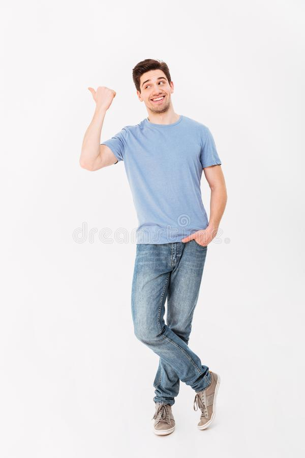 Full-length image of man in good mood presenting text or product royalty free stock photo