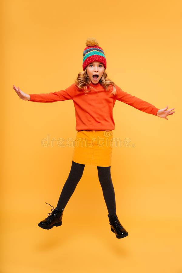 Full length image of Playful shocked Young girl in hat stock image