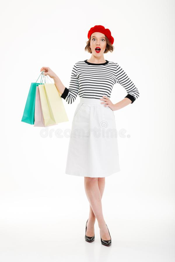 Full length image of Shocked woman with arm on hip royalty free stock photo