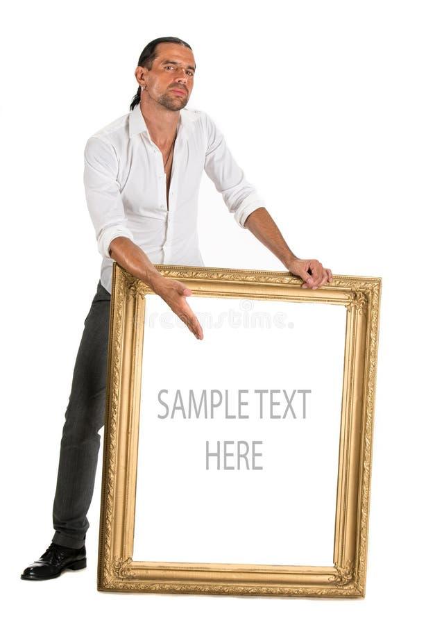 Full length of man holding a blank banner in old frame