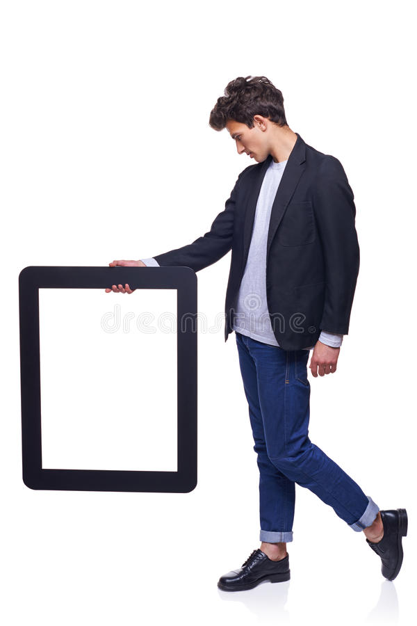 Full length man holding empty frame stock photography