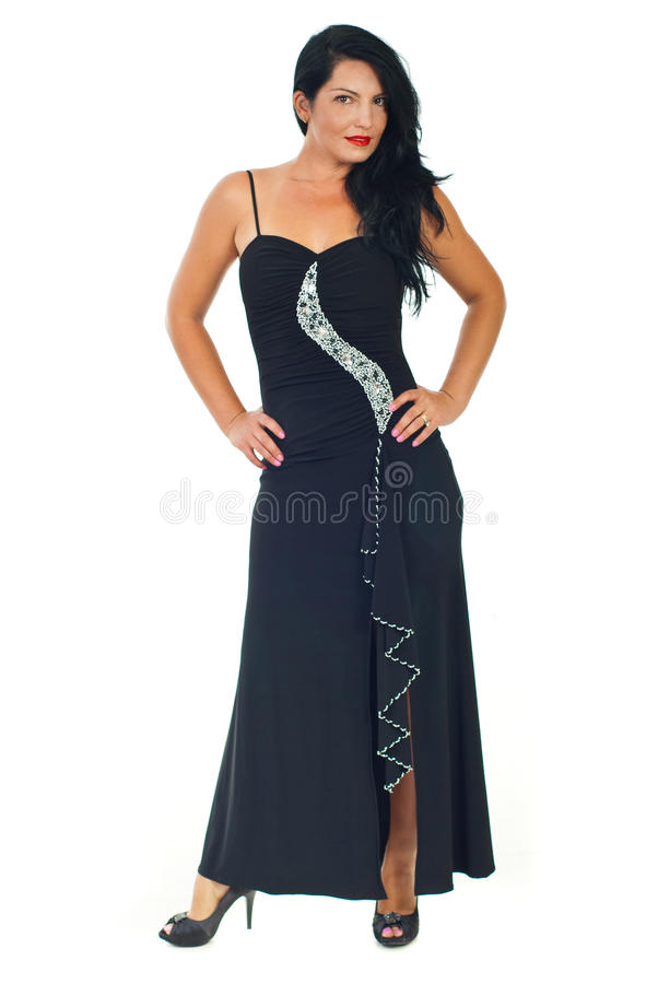 Full length of model woman in black dress. Full length of beautiful model woman in elegant black dress posing isolated on white background royalty free stock image