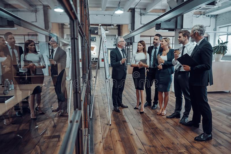 Full length of modern businessman conducting royalty free stock image