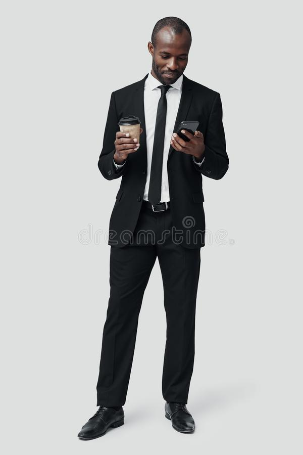 Full length of modern young African man stock photo