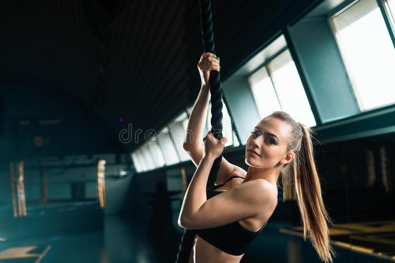 Full length narrow angle shot of a woman with climbing rope. Copyspace background with athletics healthy composition. Full length narrow angle shot of a woman royalty free stock images