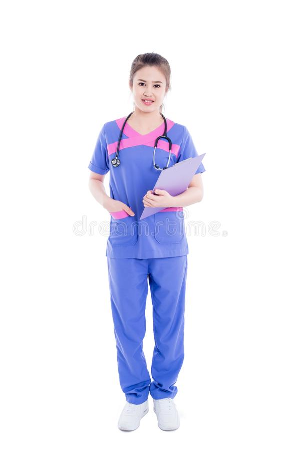 Full length of  nurse standing over white background royalty free stock photo