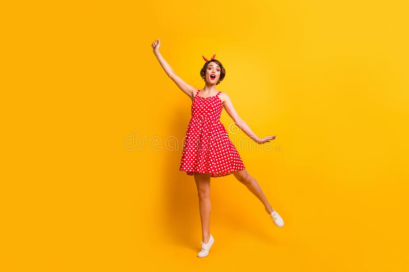 Full length photo of astonished cute pretty girl hold hand catch her flying windy weather imagination parasol scream stock photos