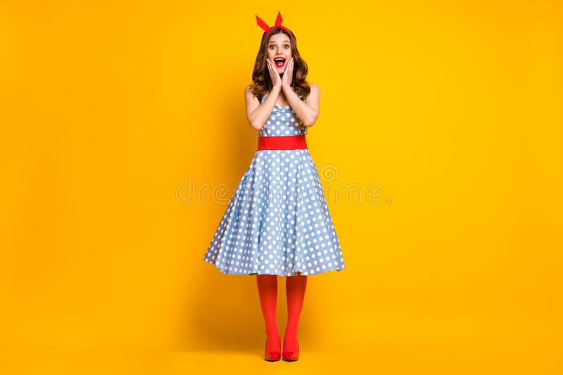 Full length photo astonished girl enjoy spring free time holiday look discount news impressed touch hands face wear red. Full length photo astonished girl enjoy stock photo