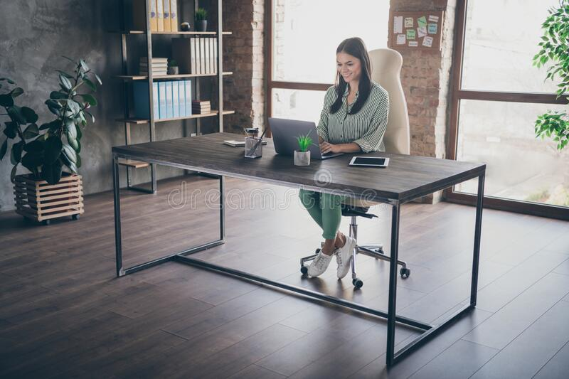 Full length photo of attractive latin business lady good mood notebook table chatting colleagues read corporate report. Full length photo of attractive latin stock photography