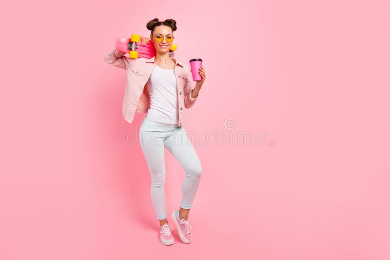 Full length photo of cheerful lady in eyeglasses eyewear holding espresso long boar isolated over pink background. Full length photo of cheerful lady in stock photography