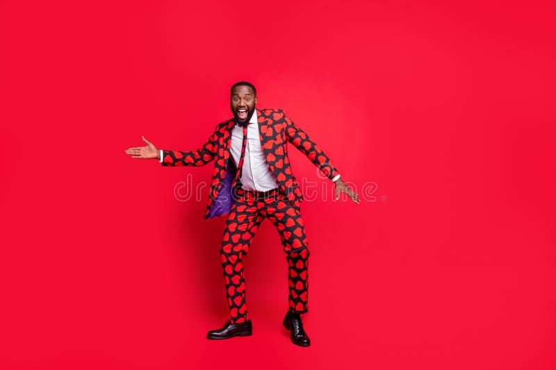 Full length photo of crazy dark skin man moving dancing playing amour cupid role at corporate valentine day party wear royalty free stock photos