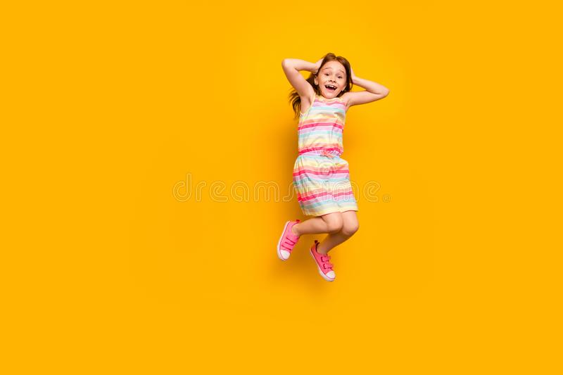 Full length photo of cute astonished child touching her head screaming shouting isolated over yellow background. Full length photo of cute, astonished child stock photos