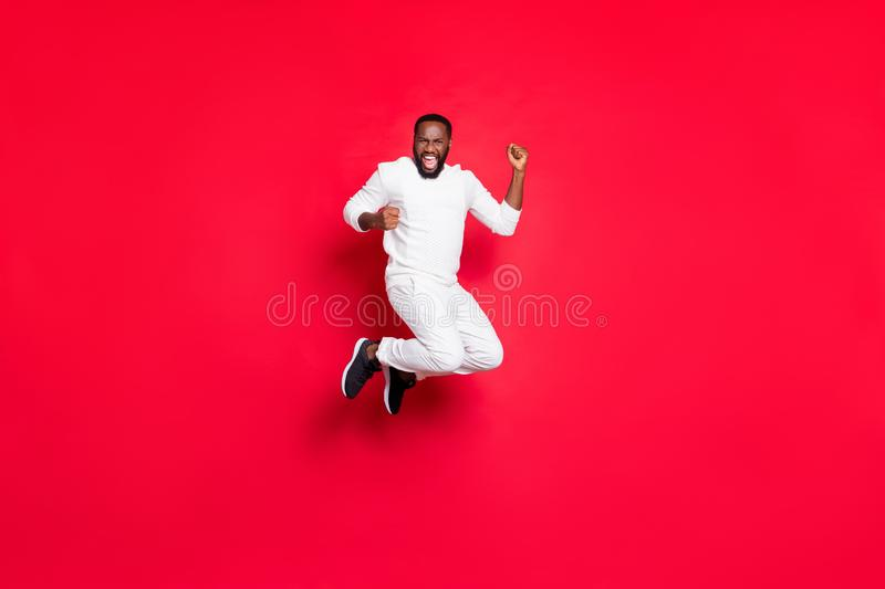 Full length photo of excited dark skin handsome guy jumping high rejoicing at best x-mas party celebrating midnight 2020. Full length photo of excited dark skin royalty free stock images