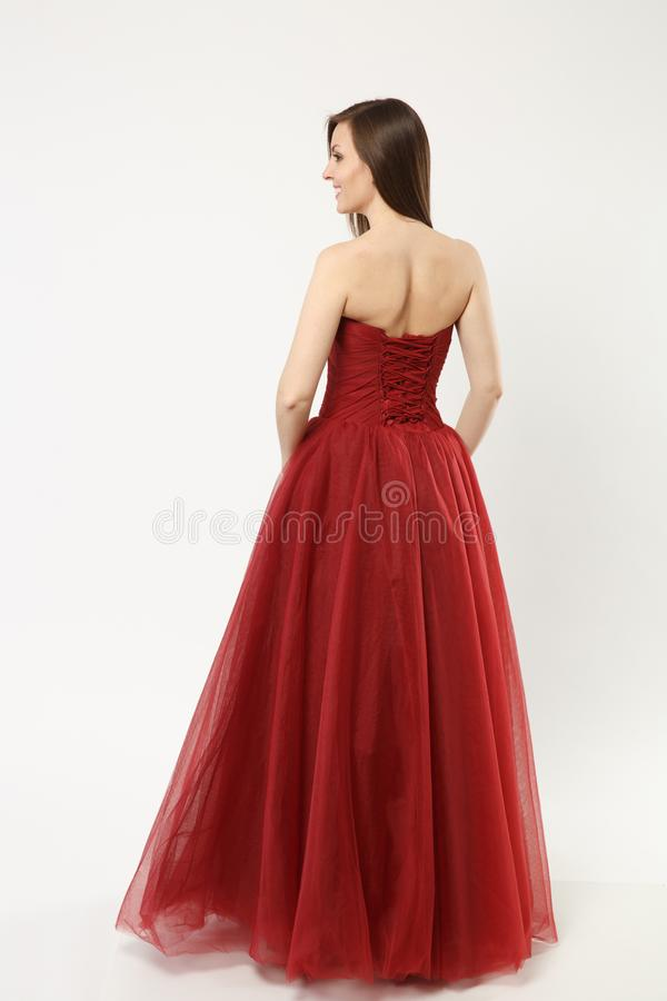 Full length photo of fashion model woman wearing elegant evening dress red gown posing isolated on white wall background royalty free stock photos