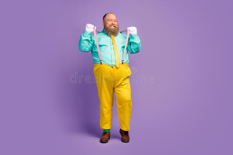 Full length photo of funky cool fat guy enjoy fre time pull pink suspenders wear good look modenr clothing shoes. Full length photo of funky cool fat guy enjoy royalty free stock image