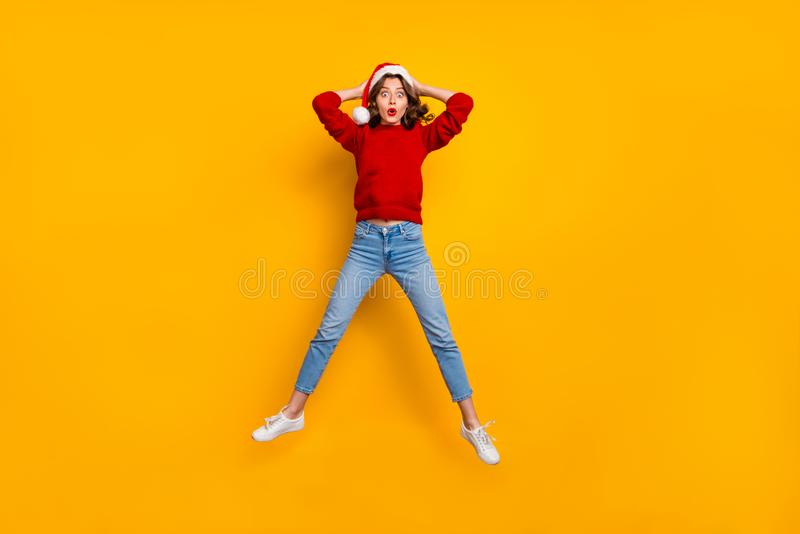 Full length photo of funky lady jumping high to see shock news wear knitted sweater isolated yellow background royalty free stock images