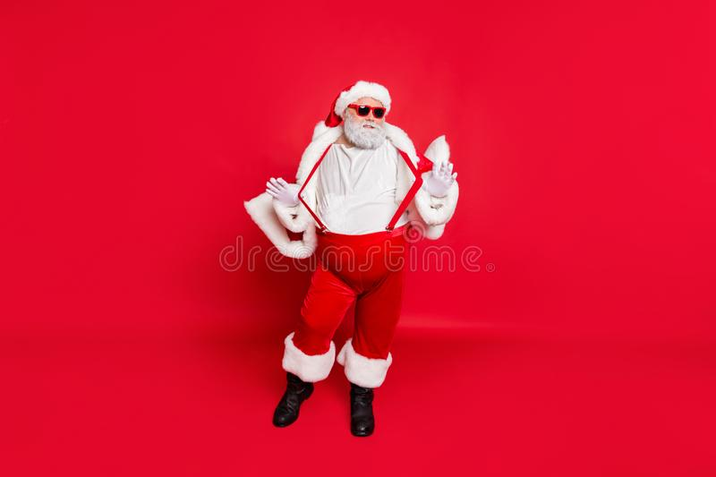 Full length photo of gorgeous white grey hair fat overweight santa in eyewear touch his suspenders feel cool wearing. Full length photo of gorgeous white grey royalty free stock photography
