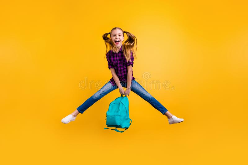 Full length photo of little pupil jump high finally holidays wear casual checkered shirt jeans denim isolated yellow royalty free stock image