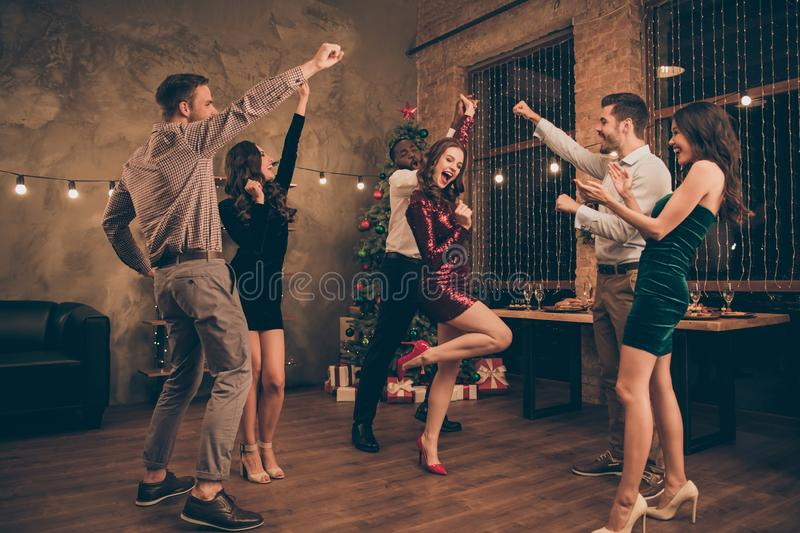 Full length photo of lovely guys and ladies having fun dancing on christmas x-mas party in house indoors stock image