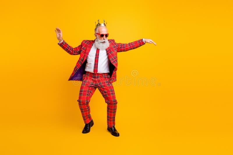 Full length photo of modern look grandpa white beard vip guy dancing strange youth moves little drunk wear crown sun stock images
