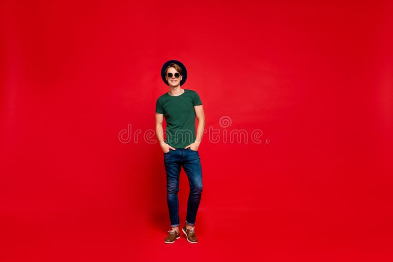 Full length photo of positive cheerful guy in blue hat real wealthy rich modest millionaire have fun on summer holidays. Full length photo of positive cheerful stock image