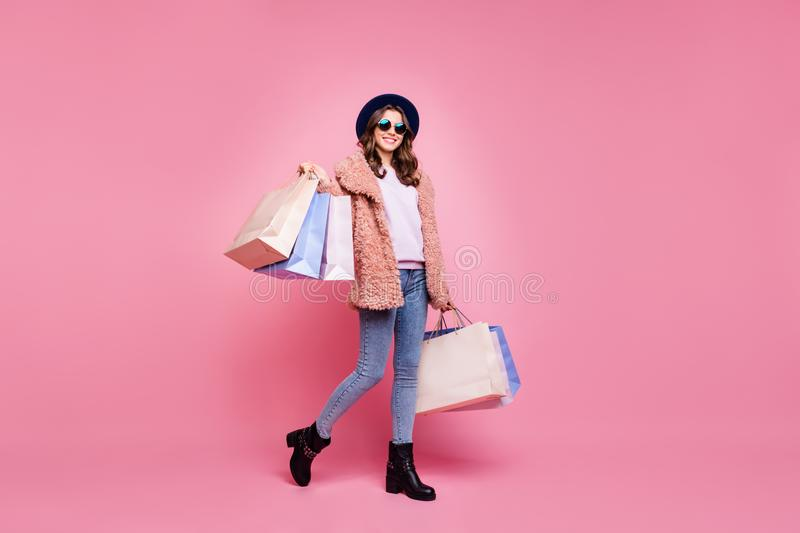 Full length photo of pretty youngster lady carry many packs shopper enjoy abroad sales mall wear fluffy jacket jeans sun royalty free stock photos
