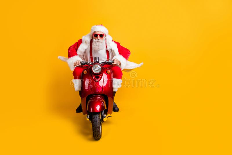Full length photo of serious santa claus in red hat drive his modern motorbike ride north-pole for christmas x-mas royalty free stock photography