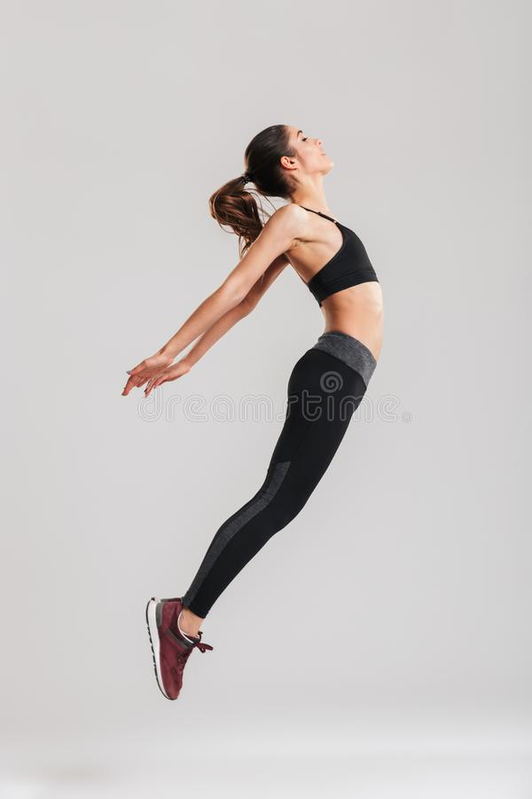 Full-length photo of skinny pretty woman in sportswear having st stock photography