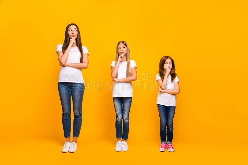 Full length photo of three minded sister ladies wear casual outfit isolated yellow background royalty free stock image