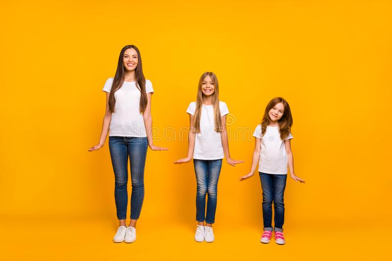 Full length photo of three sister ladies on fashion show wear casual outfit isolated yellow background stock photos