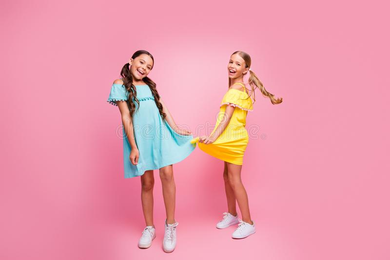 Full length photo of two funny small school ladies models rejoicing summer holidays best pupil party dancing wear bright royalty free stock photo