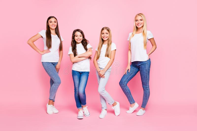 Full length photo of two small and two students ladies wear casual outfit isolated pink background stock photography