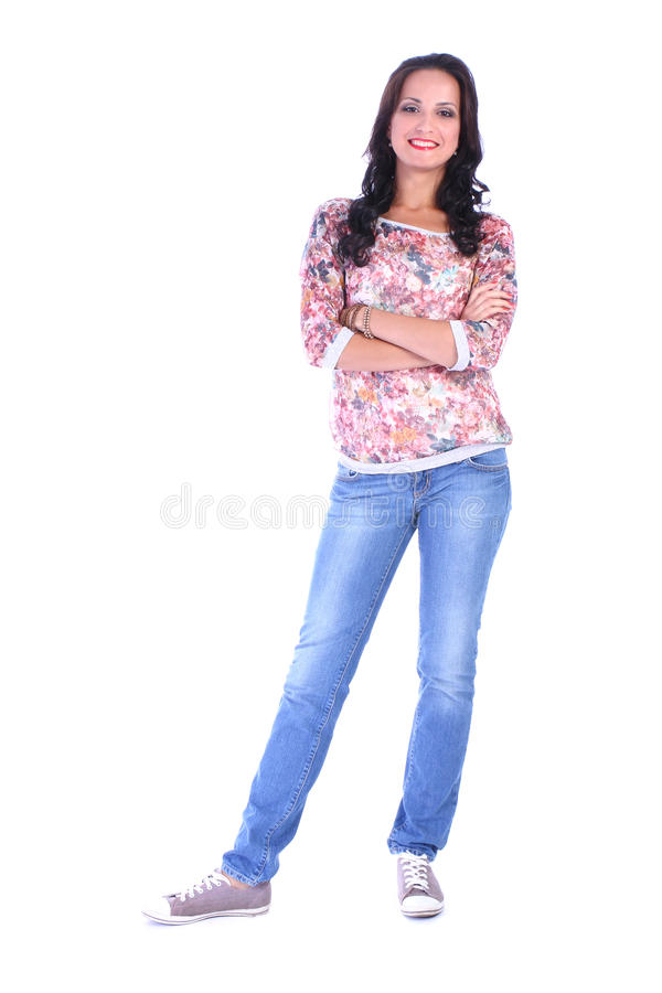 Full length picture of young woman in jeans standing. On white background stock photos