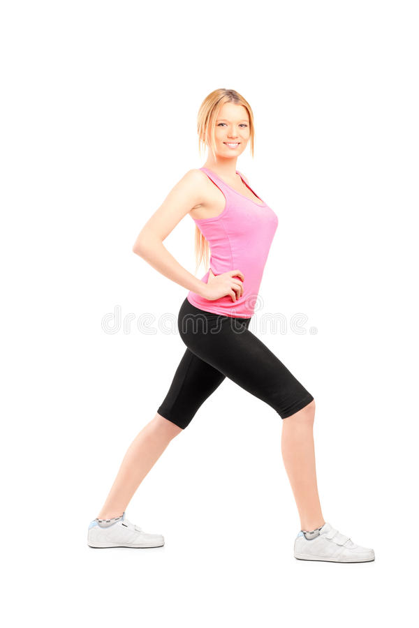 Download Full Length Portrait Of An Active Young Woman Exercising Stock Image - Image: 28599793