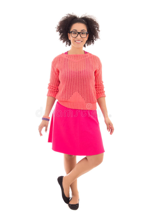 Full length portrait of african american teenage girl in pink i. Solated on white background stock image
