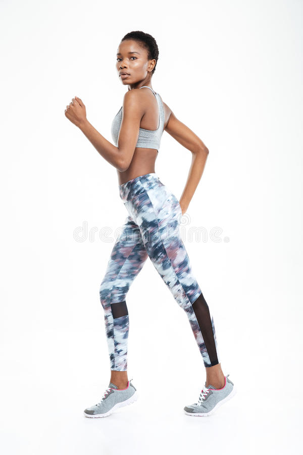 Full length portrait of afro american woman running stock photos