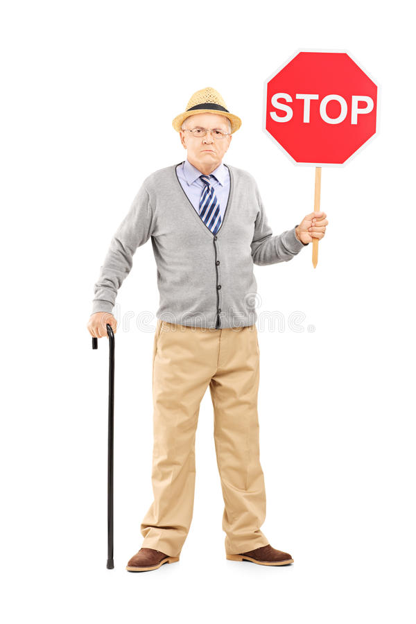Download Full Length Portrait Of An Angry Mature Gentleman Holding A Stop Stock Image - Image: 33041759