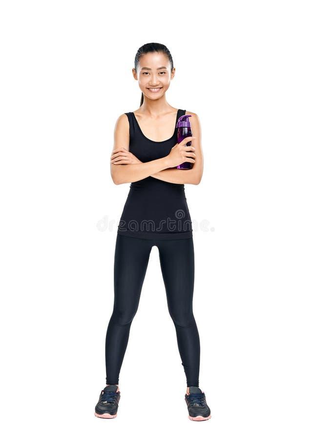 Full length portrait of Asian woman holding bottle of water stock image