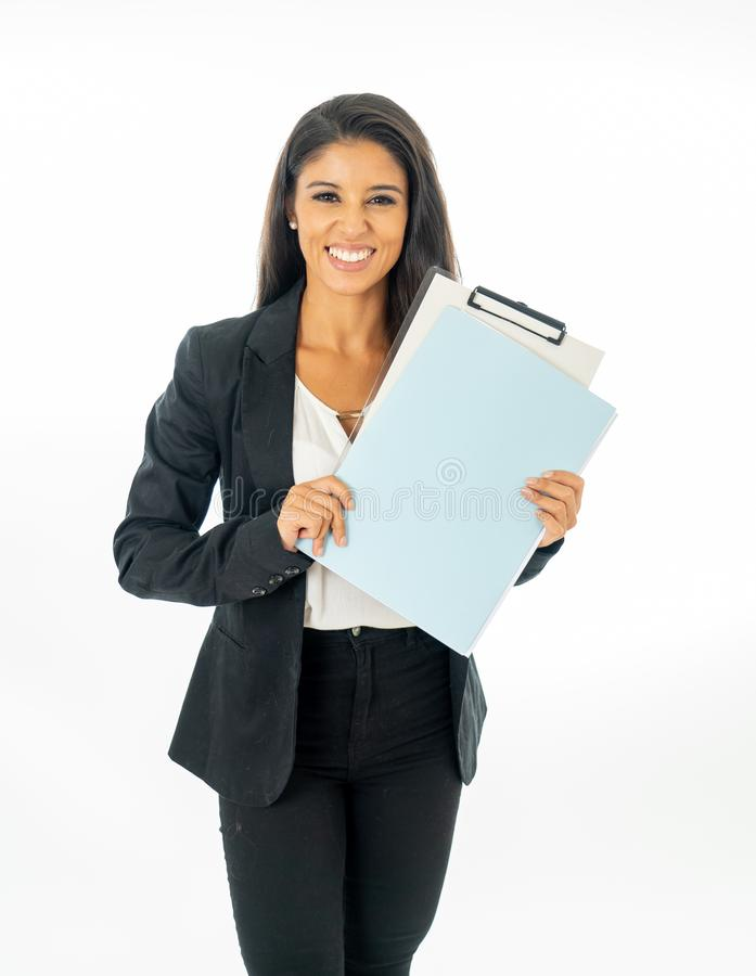 Full length portrait of Attractive latin corporate latin woman looking excited and holding a folder and paperwork in Creative royalty free stock photography