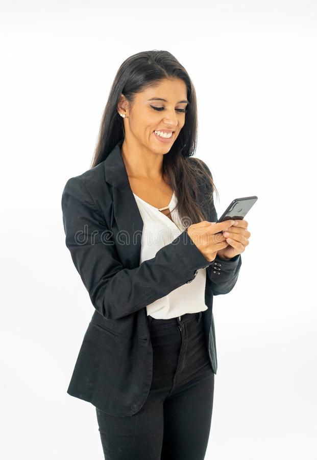 Full length portrait of Attractive latin corporate latin woman looking happy and confident using smart phone in Creative Success royalty free stock photos